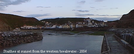A view looking back towards the town from the western breakwater at dusk